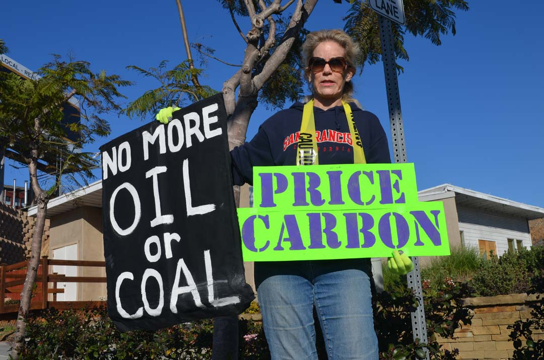 Eve Simmons takes part in a rally on Sunday in Encinitas. Photo by Tony Cagala