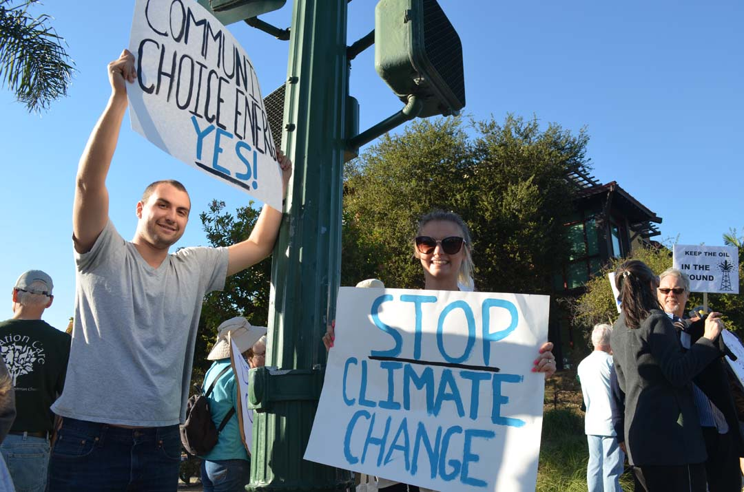 Peter Peilaet-Strayer, 22, with his girlfriend Chaya-Anna Leibel, 21, attend the climate change rally on Sunday. Photo by Tony Cagala