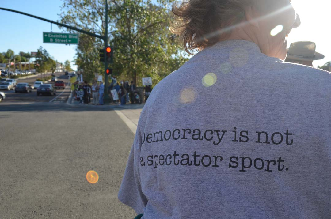 Poppy Demarco-Dennis gets involved during the climate change rally in Encinitas. Photo by Tony Cagala