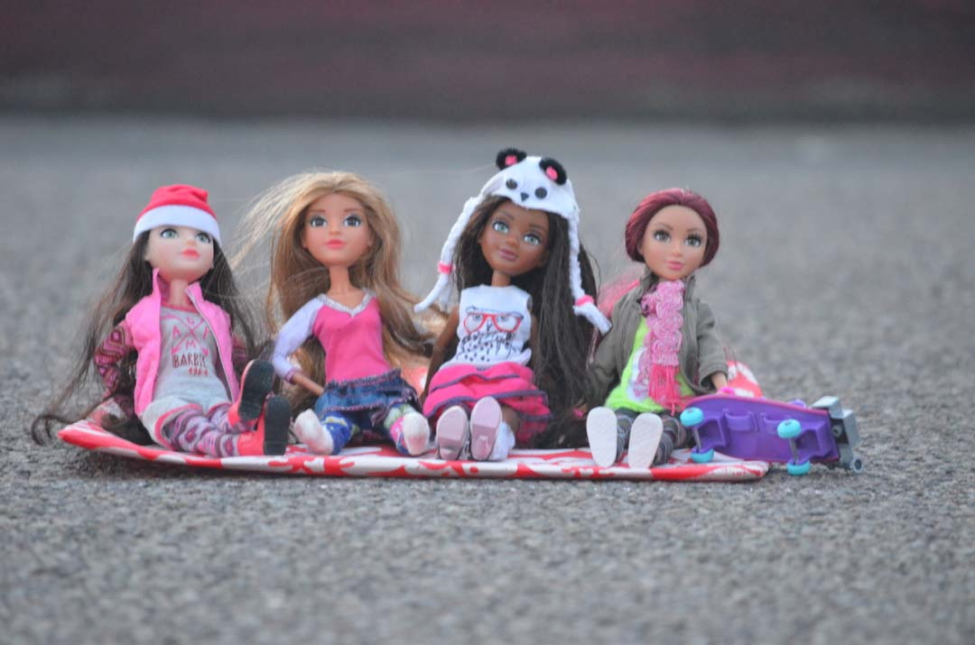 Anyone who's anyone attends the Encinitas Holiday Parade, including these four dolls that got a prime spot along the parade route. Photo by Tony Cagala