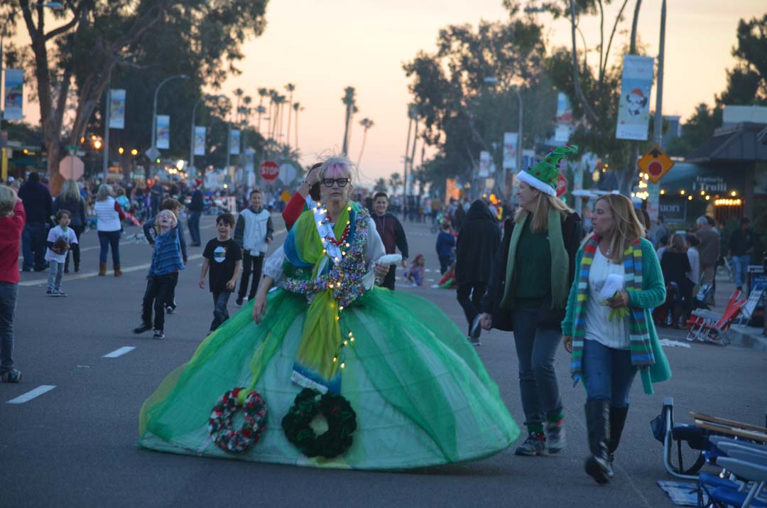 Cindy Semeniuk of Mission Estancia School walks down Coast Highway 101 before the start of the parade. Photo by Tony Cagala