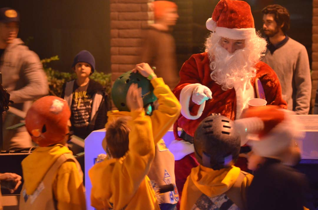 Kids get a prime chance to meet with Santa at the Nixon float before the start of the Encinitas Holiday Parade. Photo by Tony Cagala