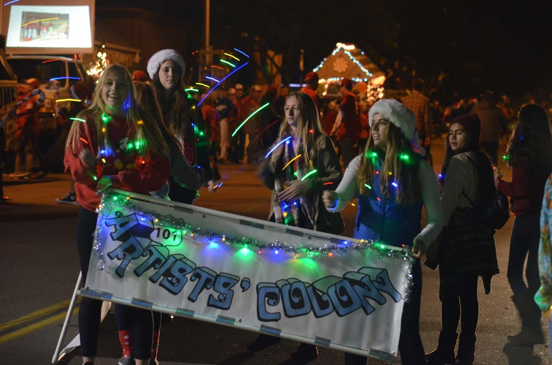 Teens have some fun with lights prior to the parade. Photo by Tony Cagala