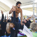 Alejandro Maldonado, Mexico's yoga guru, leads followers in warm-up stretching during a recent two-hour session staged on the grounds of the Hotel Coral and Marina near Ensenada.