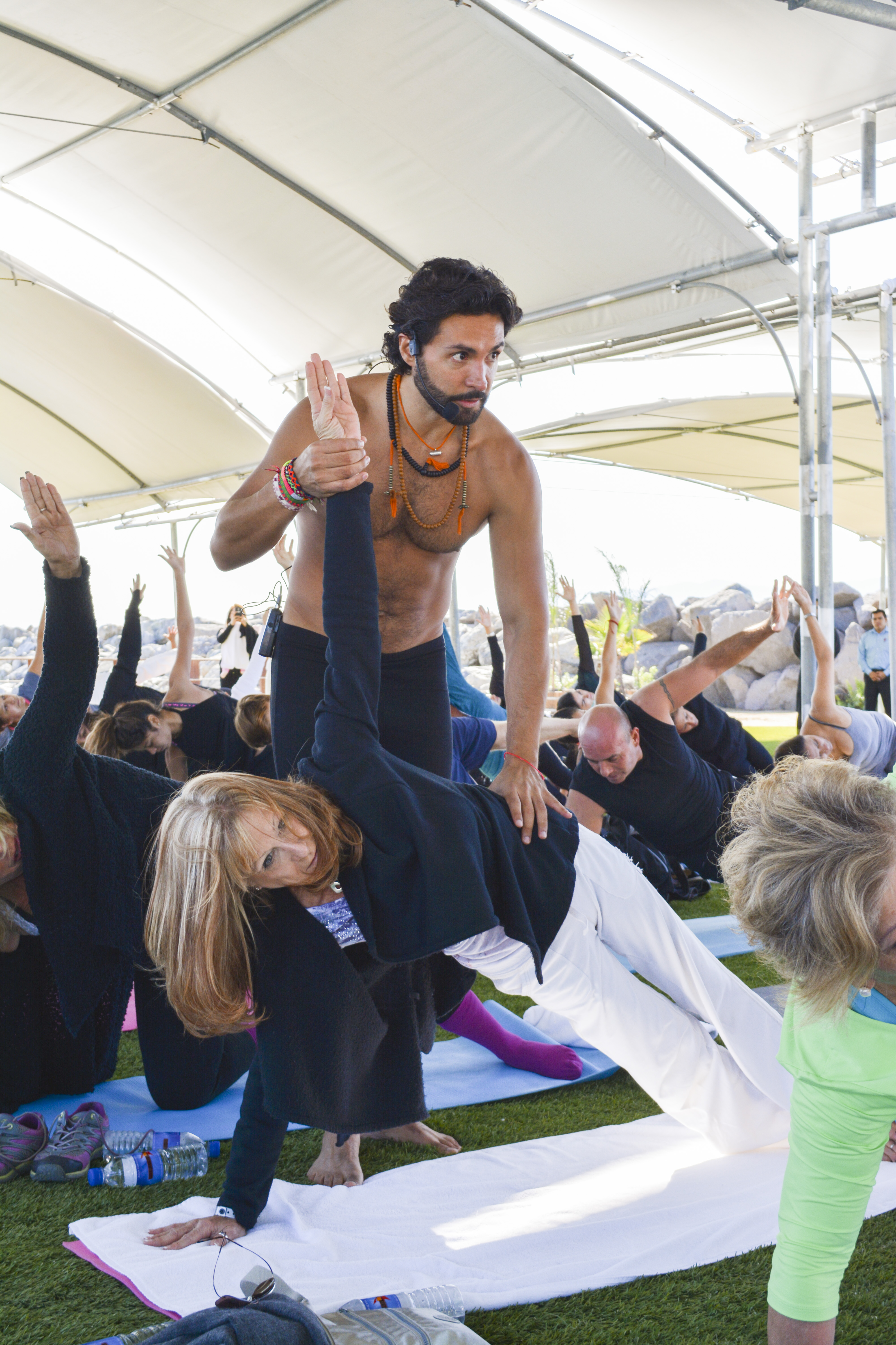 Alejandro Maldonado, Mexico's yoga guru, leads followers in warm-up stretching during a recent two-hour session staged on the grounds of the Hotel Coral and Marina near Ensenada. Photo by Alejandra Castro