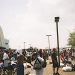 """Some Superdome residents gather in the outdoor mezzanine area for some fresh air not long after Hurricane Katrina hit. According to Paul Harris, """"no one was allowed to leave, and we were told there was martial law and we would either be shot or arrested if we left."""""""