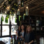 Nicole Dorsey (L) of Los Angeles and Giselle Lazarus of Carlsbad, participants in the four-day wellness program at Hotel Coral in Ensenada, relax in the tasting room at Quinta Monasterio Winery.