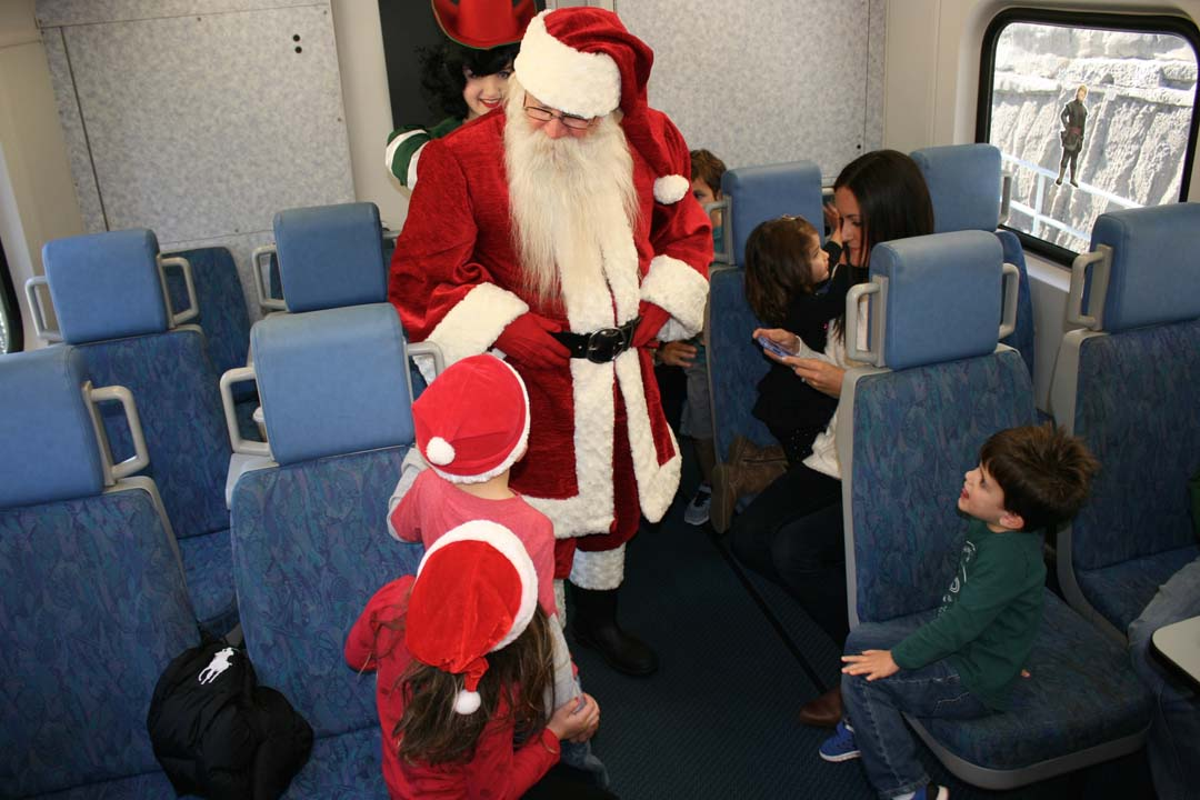 Boys and girls on the Holiday Express get a visit from Santa. For some kids it's also their first train ride. Photo by Promise Yee