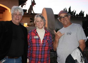 From left , electrical construction contractor Jim Filanc, Encinitas Historical Society President Carolyn Cope, and community volunteer Louis Ortiz make the annual tree lights happen. Ortiz began lighting the heritage tree for the holidays 21 years ago. Photo by Promise Yee