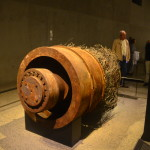 """This 8-foot-by-5-foot elevator motor with a 10,000-pound capacity (most have a 3,500-pound capacity) likely came from the North Tower. It was installed in 1969. On Sept 11, 2001, it was used to evacuate thousands of people. John Menville, who installed it, also maintained it for 32 years. According to news accounts, """"Menville was in Tower 2 when the first plane hit. He evacuated and raced to a friend's store…to use the phone, then headed back to the towers to help. He was standing on Church St. when Tower 2 started collapsing."""""""