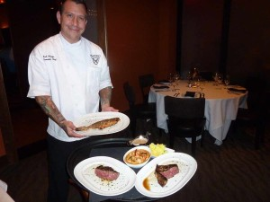 "Executive Chef Erik Wepfer of Mastro's in Palm Desert presents a ""Branzino"" whole Mediterranean fish with his four-course menu. Photo by Frank Mangio"