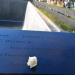 A visitor to the National September 11 Memorial, two acre-sized pools with 30-foot waterfalls built in the original footprints of the Twin Towers, has left a white rose at the name of one of the victims. The memorial honors the nearly 3,000 people killed at the World Trade Center, the Pentagon, near Shanksville, Penn., and the six people killed in the February 1993 bombing of the WTC. Every name is inscribed into bronze panels edging the pools. Often forgotten, the 1993 attack left a five-story hole in the subterranean levels of the towers and damaged a nearby hotel. More than 1,000 people were injured, including 123 first responders. About 50,000 were evacuated, including more than 100 visitors (some young children) who had to walk down 107 flight of stairs because the power was out.