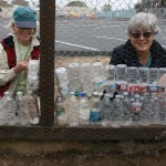 From left volunteers Kathleen Lees and Deputy Mayor Lisa Shaffer build a greenhouse wall out of plastic water bottles. Engage Encinitas organized the community workday at Ocean Knoll Educational Farm. Photo by Promise Yee