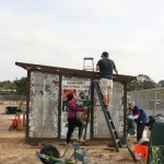 Engage Encinitas volunteers pitch in to repair the Ocean Knoll Educational Farm greenhouse. The group meets for community service, informational lectures and city tours. Photo by Promise Yee