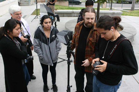 High school students learn photojournalism skills