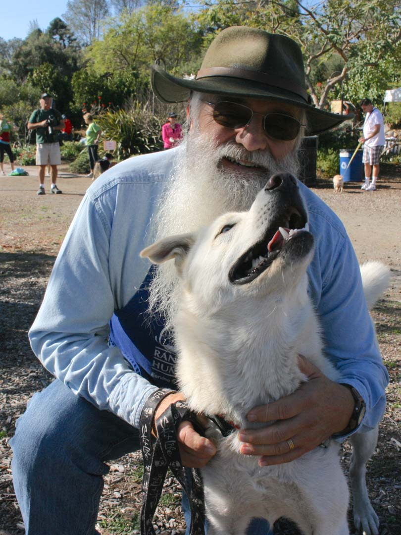 Rancho Coastal Humane Society volunteer Mark Stidemann walks a husky mix from the animal shelter. Rancho Coastal and San Diego Botanic Garden partner to hold the annual dog and owner 5k. Photo by Promise Yee