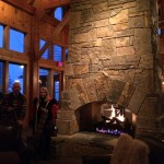 The huge stone fireplace at the Club at Cordillera near Edwards, Colo., provides a cozy gathering space on a snowy night