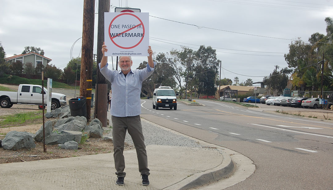 Arnold Wiesel, who lives near Watermark Del Mar, protests the proposed multifamily development slated for the intersection of Jimmy Durant Boulevard and San Dieguito Drive during a Jan. 30 open house introducing the project. Photo by Bianca Kaplanek