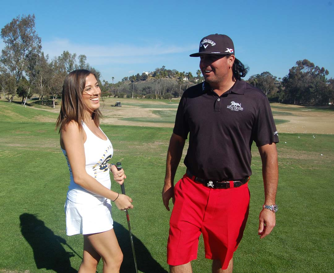 Encinitas resident Jenny Malaga, a member of the Pad Squad, shares a laugh with professional golfer Pat Perez. Photo by Bianca Kaplanek