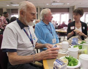 "Marine and World War II veterans Vic Freudenberger, left, Walt ""Val"" Valentine, middle, and Honor Flight volunteer Donna Hester gathered for lunch last week at the Carlsbad Senior Center. Photo by Steve Puterski"