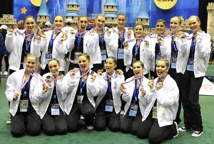 The Carlsbad High School Lancer Dancers show off their world championship medals after winning the title last weekend in Orlando, Fla. The team also took third place in the Universal Dance Association National Championships for jazz and hip-hop. Courtesy photo
