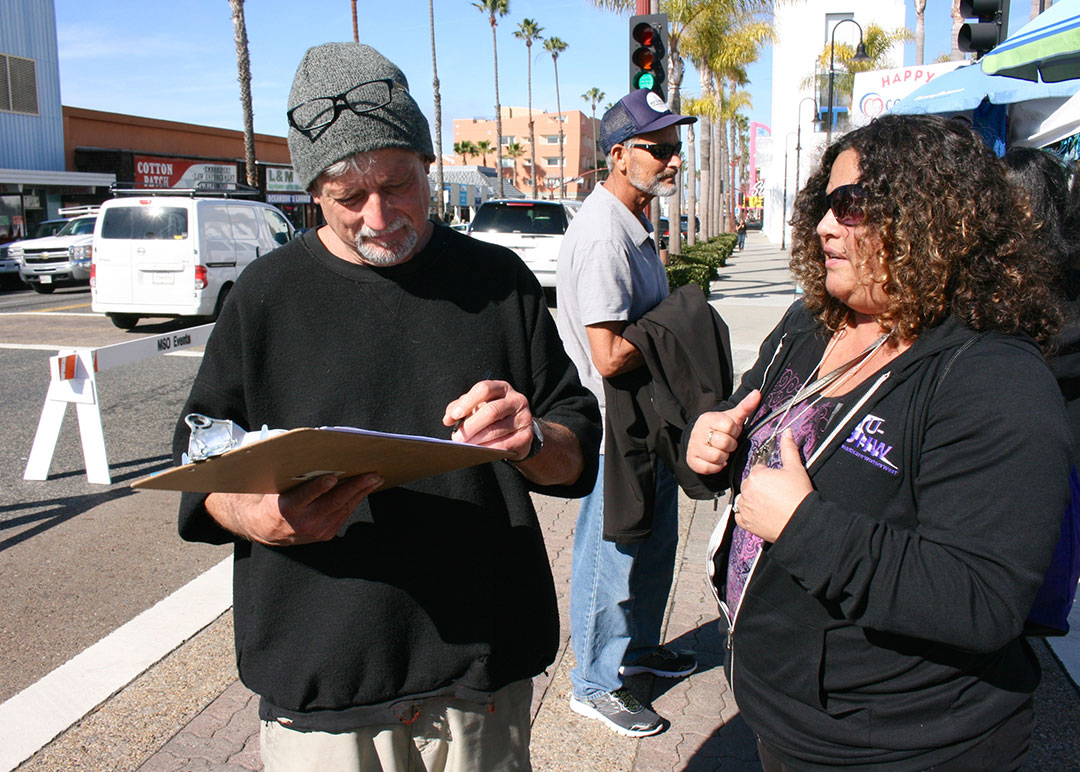 Tri-City workers collect signatures to cap administrators' pay