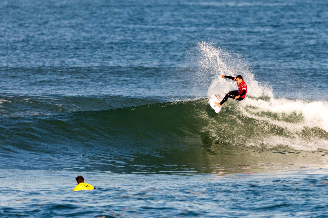 Surfers from various surf shops around San Diego County compete in the Oakley Surf Shop Challenge held in 2-3 foot surf at Seaside Reef in Cardiff on Friday. Photo by Bill Reilly