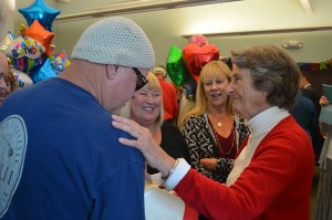 Cardiff-by-the-Sea resident, volunteer and columnist Irene Kratzer shares a moment with friends and family wishing her happy birthday on Tuesday. Photo by Tony Cagala