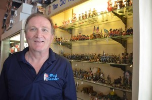 Craig McClain at his Vista home, which is filled with toy soldier collectibles. McClain is readying to co-host the 27th annual West Coaster Toy Soldier Show in Anaheim Saturday. Photo by Tony Cagala