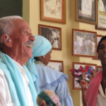 """Musicians at Guantanamo City take a break from playing Tumba music, a form of Afro-Caribbean music that features drums. This photo was taken on Christmas, which Cubans don't celebrate despite the country's Catholic roots. """"Older Cubans go to church, but religion is not terribly important to the majority of Cubans,"""" Margaret said."""