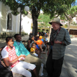Jim Janis of Carlsbad visits with Cuban locals. Many survive financially with side businesses – black marketeering; roadside produce stands; taxi service (usually horse-drawn); prostitution; and jobs in the tourist industry, valued because they draw tips.