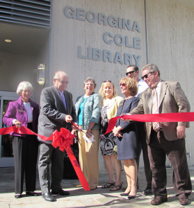 City and library officials help cut the ribbon on the grand re-opening of the Georgina Cole Library in          Carlsbad on Saturday. Photo by Steve Puterski