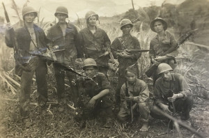 Carlsbad's Walt Travis, top row middle, and members of the Marines and Filipino guerillas pose of a photo during their time at Guadalcanal in World War II. Courtesy photo