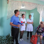 """The Road Scholar tour to Cuba took participants to a neighborhood clinic in Holguin, where they spoke with a doctor and nurses. The Cuban revolution did some good things for everyone, according to Jim and Margaret Janis. All citizens receive free medical and dental care, education through college, highly subsidized (but rationed) basic foods like rice, beans, sugar, cooking oil, some milk, and small amounts of meat. """"We came away believing that … the poorest Cubans are better off than the poorest Americans."""""""
