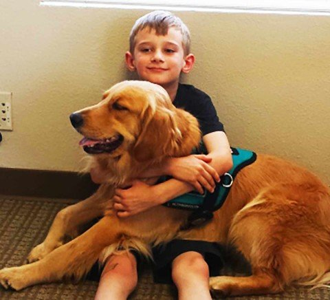 Family, groups, raise money for child to have autism service dog