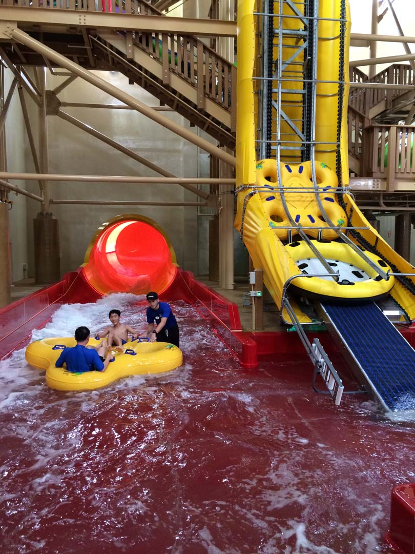 A giant conveyor belt hauls large rafts up to the top of the six-story Howlin' Tornado ride. Photo by E'Louise Ondash