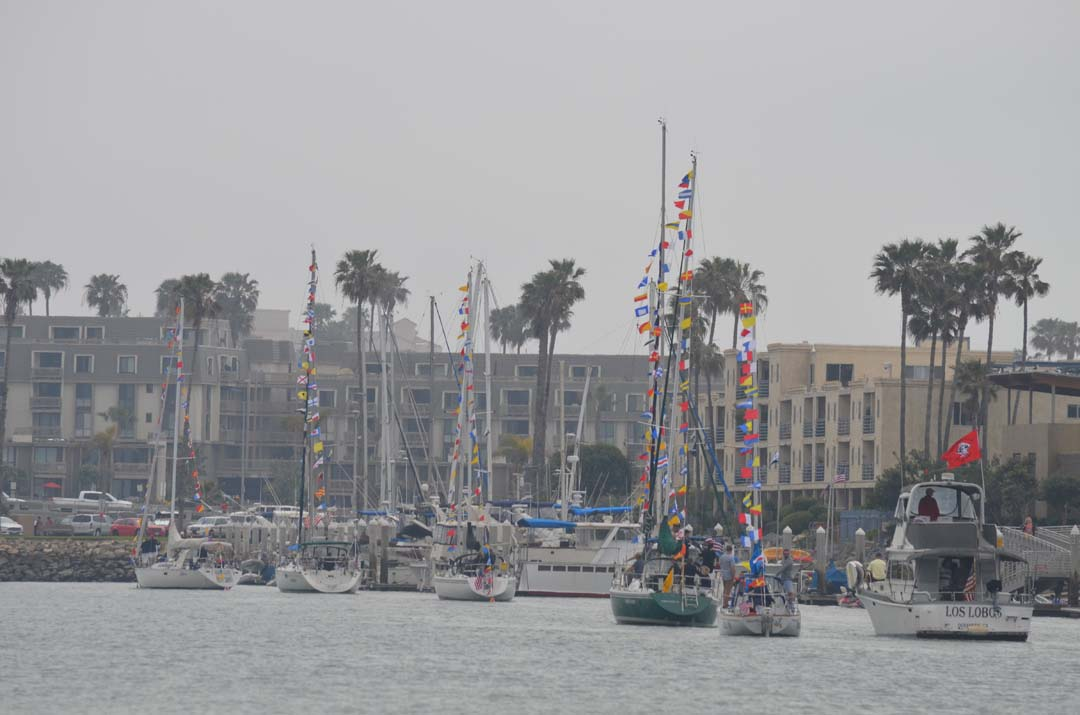Yachts, sailboats and motorboats circle the Oceanside Harbor before parading in front of the club's reviewing party for the 53rd annual Opening Day on April 3. Photo by Tony Cagala