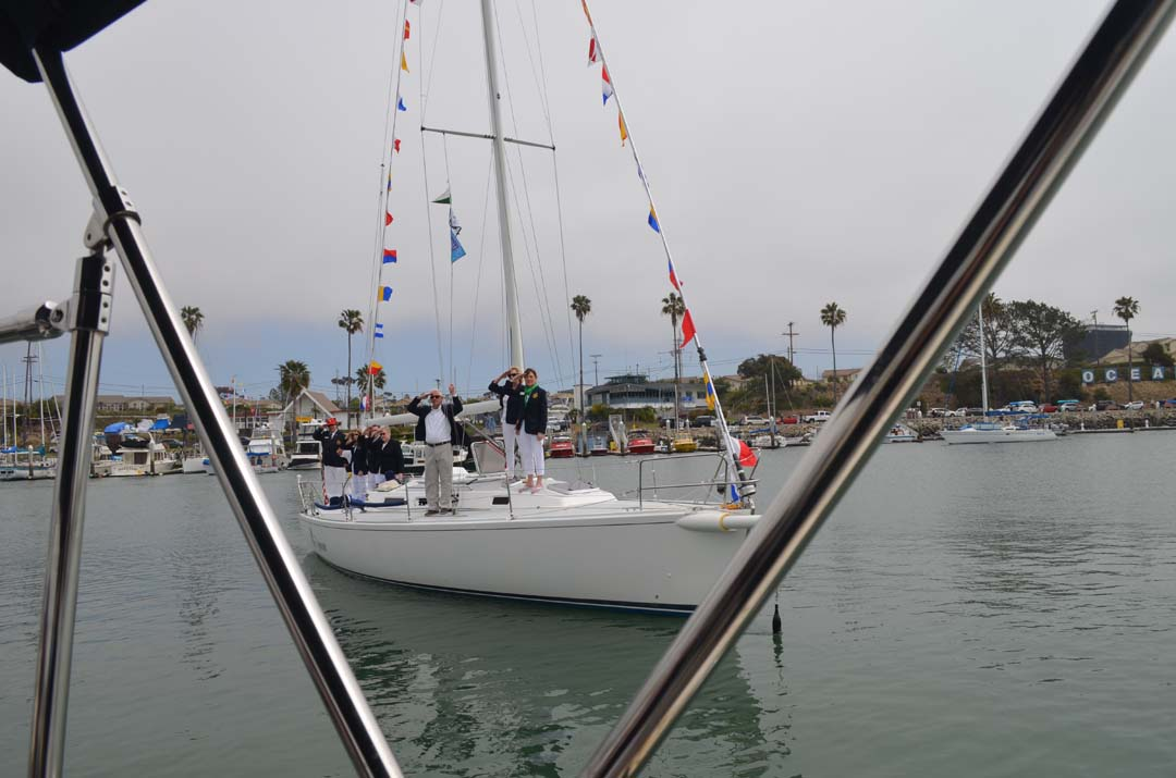 A sailboat parades through Oceanside Harbor. Photo by Tony Cagala