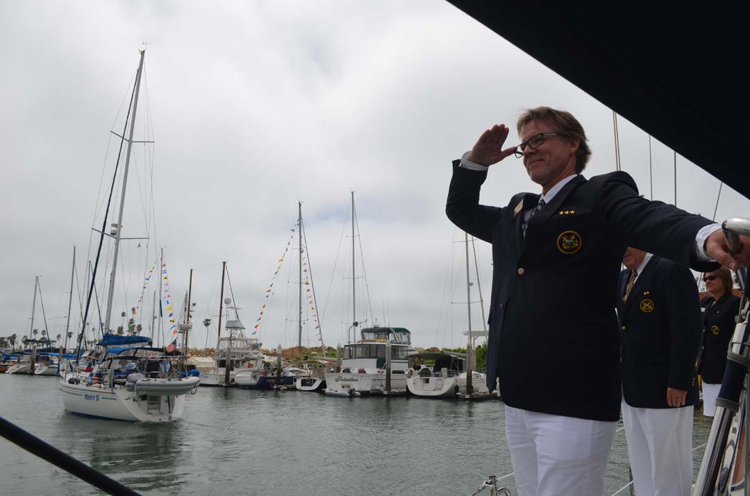 Oceanside Yacht Club's Commodore Karl Walker salutes back to club members during the 53rd annual Opening Day. Photo by Tony Cagala