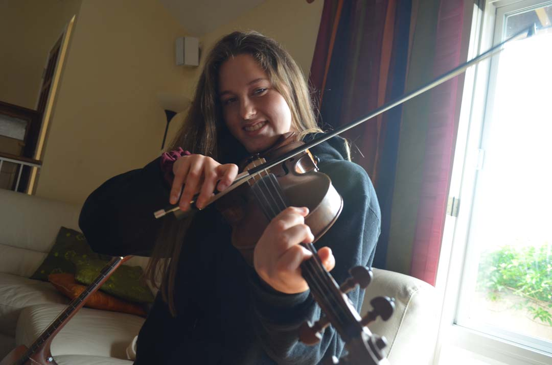 Young fiddler finds her voice through instrument