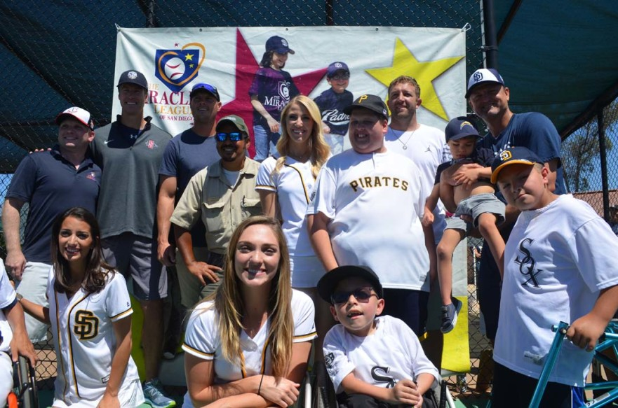 Members of the Pad Squad with professional athletes and players in the Miracle League of San Diego pose for a photo. Photo by Tony Cagala