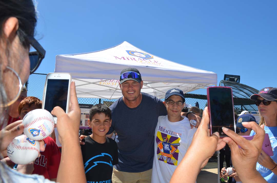 San Diego Chargers quarterback Philip Rivers poses with fans after the 10th annual home run derby in Del Mar. Photo by Tony Cagala