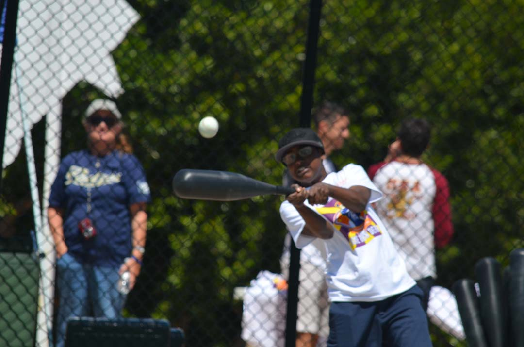 Isaac Shannon, a player with the Miracle League of San Diego, crushes one of 16 home runs on Saturday. Photo by Tony Cagala