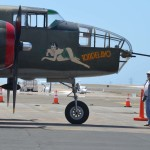 Veterans stand at the nose of a B-25 bomber on Thursday. Photo by Tony Cagala