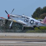 A P-51 Mustang takes off at the McClellan-Palomar Airport on Thursday. Photo by Tony Cagala