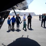 A family explores the planes in the Collings Foundation's Flying History tour on Thursday. Photo by Tony Cagala