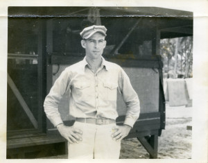 """James """"Rip"""" Harper of Carlsbad stands outside a hut during World War II. Courtesy photo"""