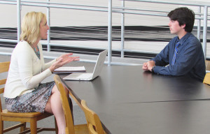 City of Carlsbad Communications Manager Kristina Ray, left, interviews a Carlsbad High School student during Monday's mock interviews as part of the schools academy internship program. Photo by Steve Puterski