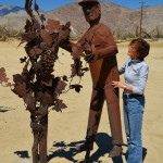 Sandy Fitzpatrick of Ladera Ranch in Orange County checks out one of the metal sculptures in a group of figures depicting the planting and harvesting of grapes. Ricardo Breceda of Temecula is the artist.