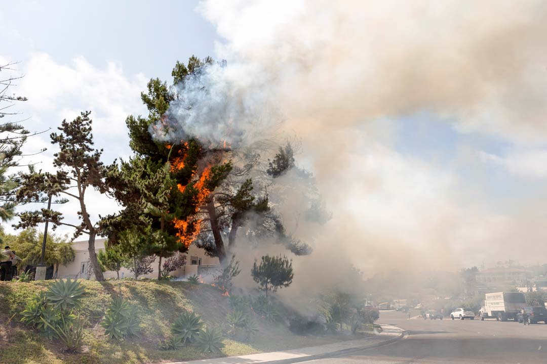 Encinitas Sheriff's Deputies assess a fire that appears to have originated on the grounds of the San Dieguito United Methodist Church on Calle Magdalena in Encinitas. Photo by Bill Reilly
